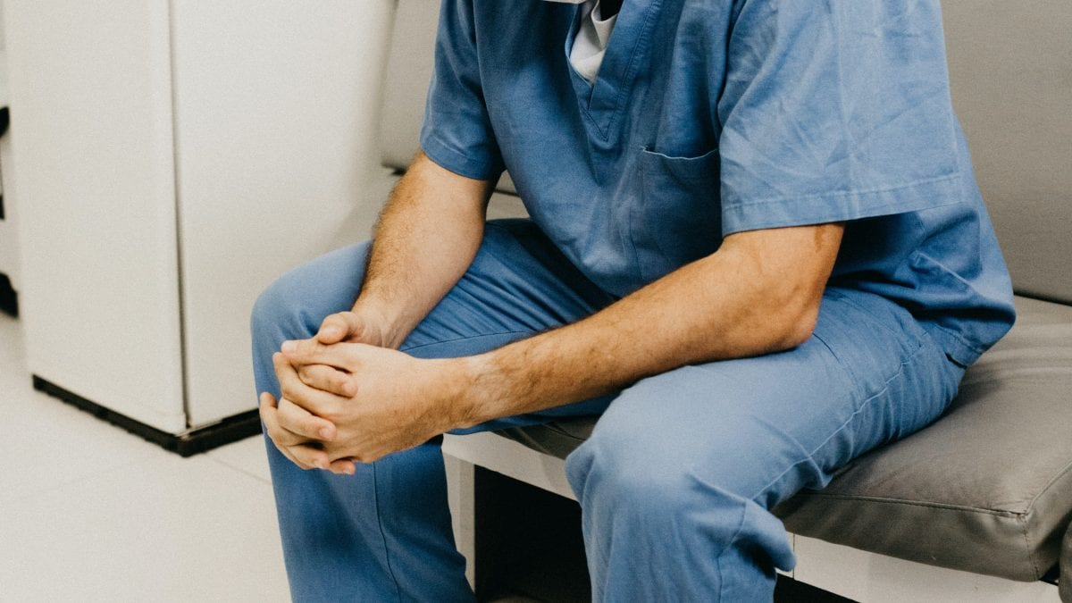 nurse sitting on bench